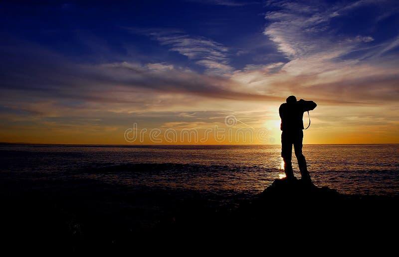 ηλιοβασίλεμα φωτογράφων στοκ εικόνα