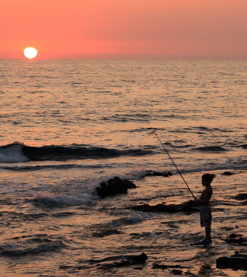 ηλιοβασίλεμα ψαράδων στοκ εικόνες