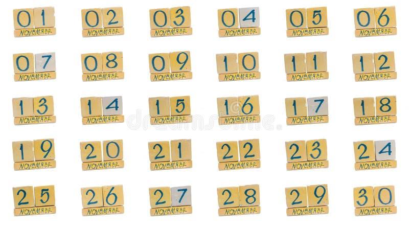 ημερολόγιο Νοέμβριος πλήρης μήνας μέρα με τη μέρα όλες οι ημερομηνίες του μήνα στη διαταγή Χειροποίητο ξύλινο ημερολόγιο κύβων στοκ εικόνα