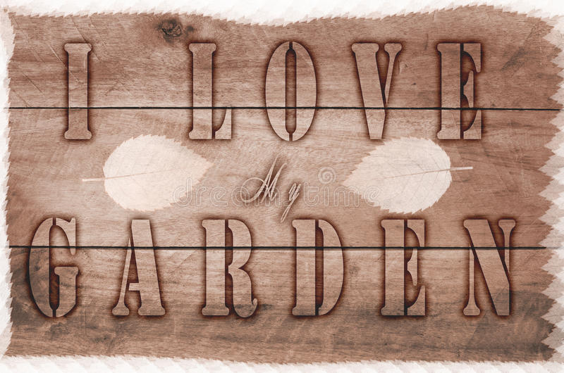 Η λέξη Ι αγαπά τον κήπο μου γραπτό, μμένες επιστολές στο ξύλινο καφετί υπόβαθρο στοκ φωτογραφία με δικαίωμα ελεύθερης χρήσης