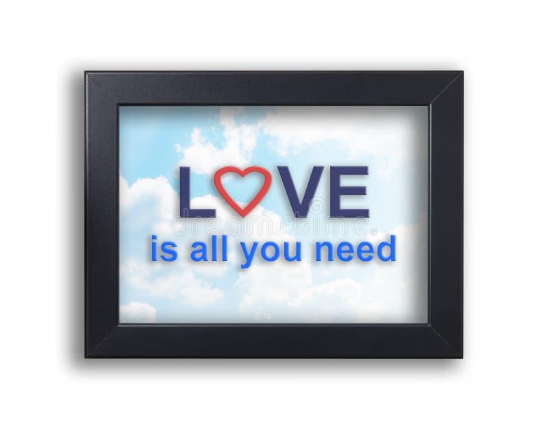 Η αγάπη είναι όλη που χρειάζεστε το κείμενο σε ένα πλαίσιο υποβάθρου ουρανού στοκ εικόνες