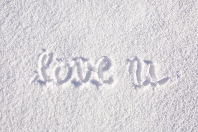 Η αγάπη εσείς γραπτοί κοντά παραδίδει το χιόνι στοκ εικόνες