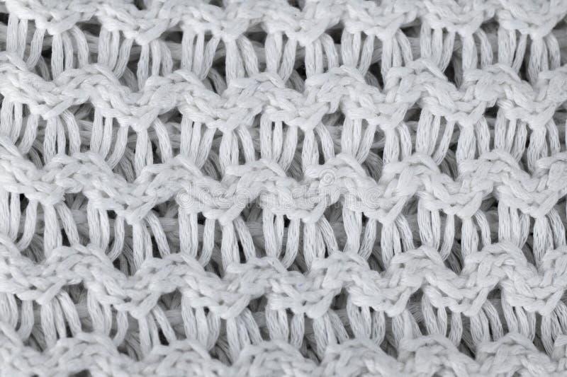η ανασκόπηση έπλεξε το λευκό μάλλινο πλεκτά θερμά ενδύματα για το υπόβαθρο σύστασης χειμερινού υφάσματος στοκ εικόνες