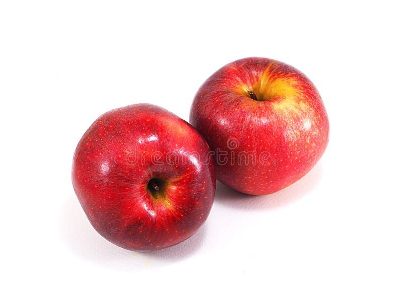 η ανασκόπηση μήλων κλείνει ένα κόκκινο επάνω λευκό στοκ φωτογραφίες με δικαίωμα ελεύθερης χρήσης