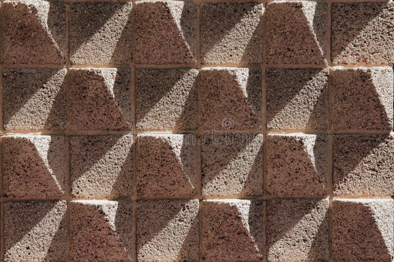η ανασκόπηση χρωματίζει grunge τον τοίχο πετρών στοκ φωτογραφίες