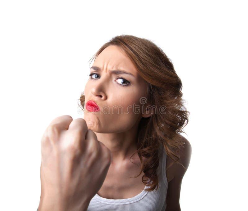 Η αστεία νέα γυναίκα εμφανίζει πυγμή που απομονώνεται στοκ εικόνες με δικαίωμα ελεύθερης χρήσης