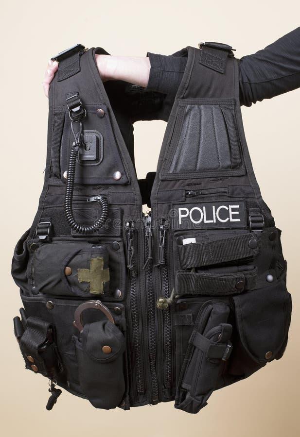Η αστυνομία εκδίδει την τακτική φανέλλα στοκ φωτογραφία με δικαίωμα ελεύθερης χρήσης