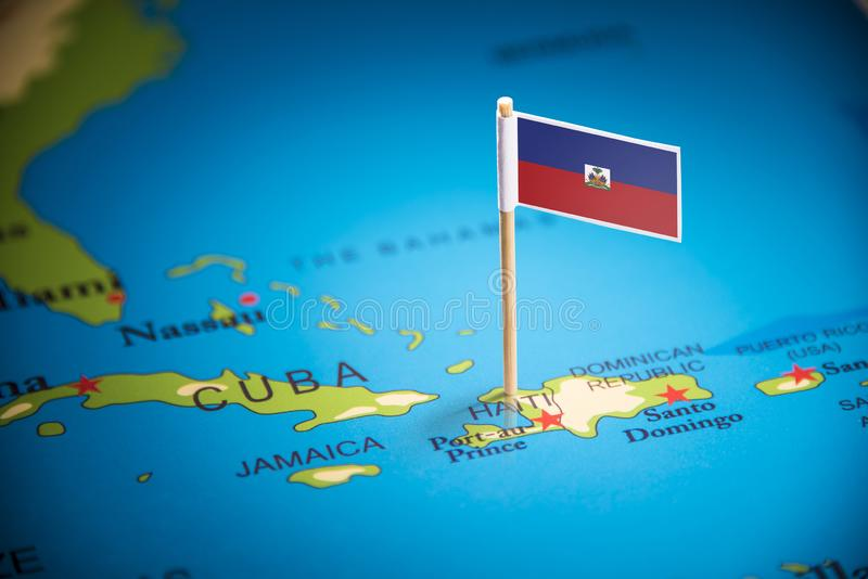 Η Αϊτή εμαρκάρισε με μια σημαία στο χάρτη στοκ εικόνα με δικαίωμα ελεύθερης χρήσης