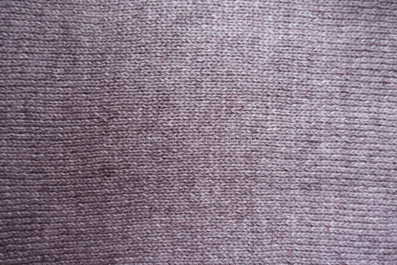 Η βασική κρόκη Puce πλέκει το ύφασμα στοκ εικόνα