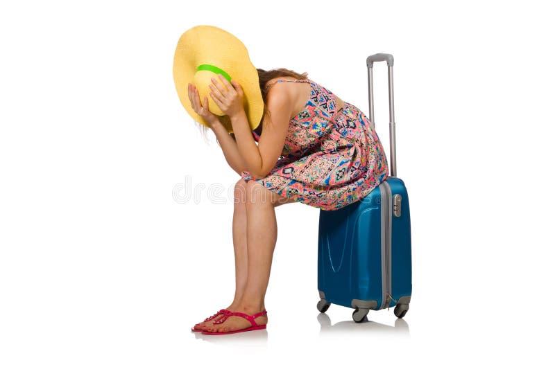 Η γυναίκα με τη βαλίτσα που απομονώνεται στο λευκό στοκ εικόνα