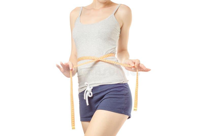 Η γυναίκα χάνει το εκατοστόμετρο slimness βάρους στοκ εικόνες με δικαίωμα ελεύθερης χρήσης