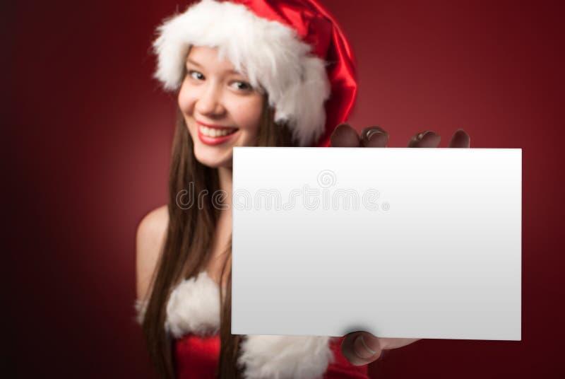 Η Δεσποινίς Santa's που παρουσιάζει σας μήνυμα! στοκ φωτογραφία με δικαίωμα ελεύθερης χρήσης