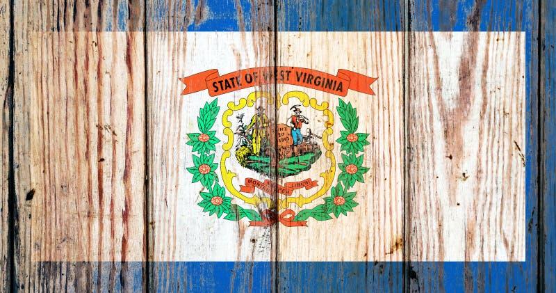 Η δυτική Βιρτζίνια ΗΠΑ δηλώνει τη εθνική σημαία σε ένα γκρίζο ξύλινο υπόβαθρο πινάκων την ημέρα της ανεξαρτησίας στα διαφορετικά  στοκ εικόνα