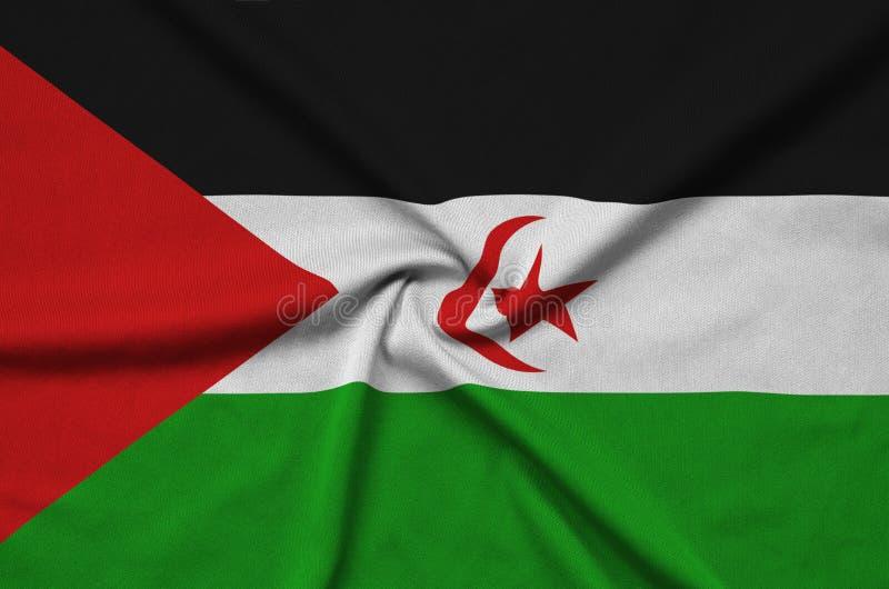 Η δυτική σημαία Σαχάρας απεικονίζεται σε ένα ύφασμα αθλητικών υφασμάτων με πολλές πτυχές Έμβλημα αθλητικών ομάδων στοκ εικόνες