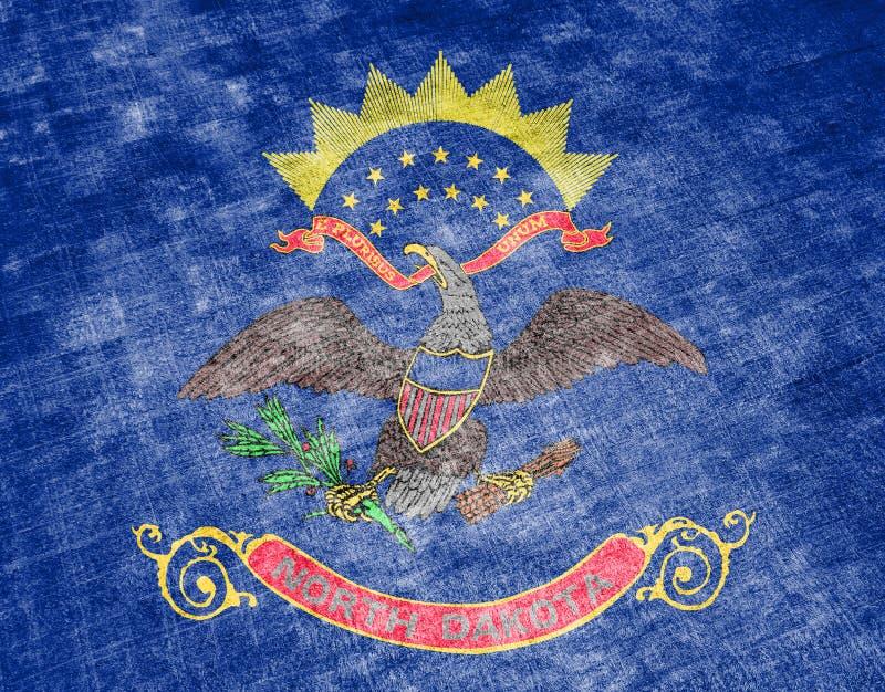 Η εθνική σημαία των ΗΠΑ δηλώνει τη βόρεια Ντακότα μέσα ενάντια σε ένα γκρίζο υφαντικό κουρέλι την ημέρα της ανεξαρτησίας στα διαφ ελεύθερη απεικόνιση δικαιώματος