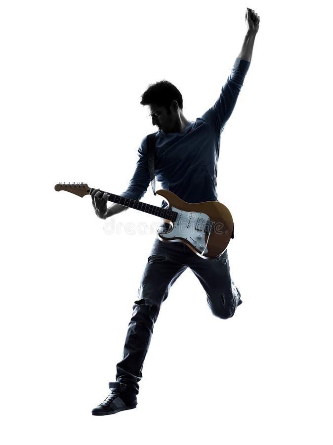 Ηλεκτρική σκιαγραφία παιχνιδιού φορέων κιθαριστών ατόμων στοκ εικόνα με δικαίωμα ελεύθερης χρήσης