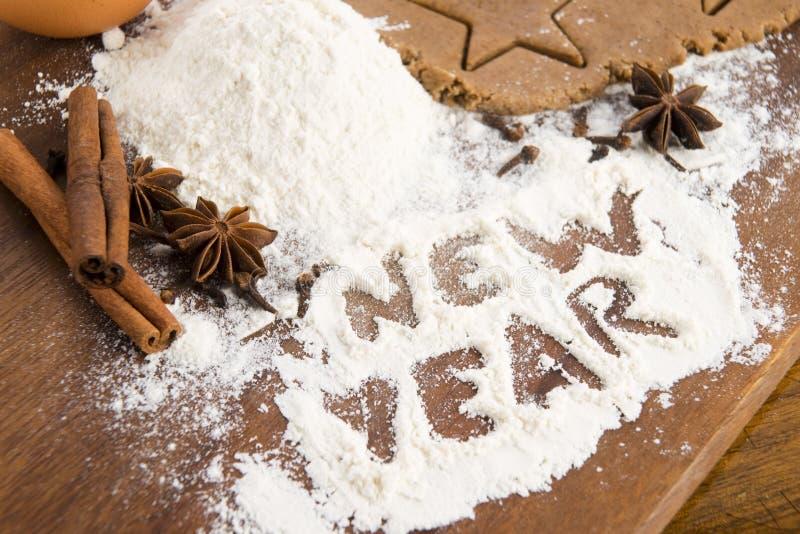 Η επιγραφή στο αλεύρι - νέο έτος στοκ φωτογραφίες