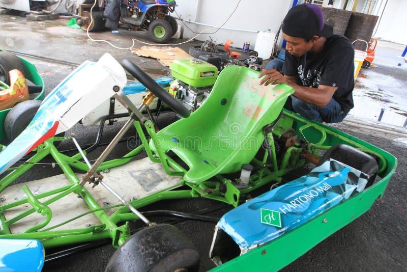 Η επισκευή πηγαίνει kart στοκ φωτογραφία