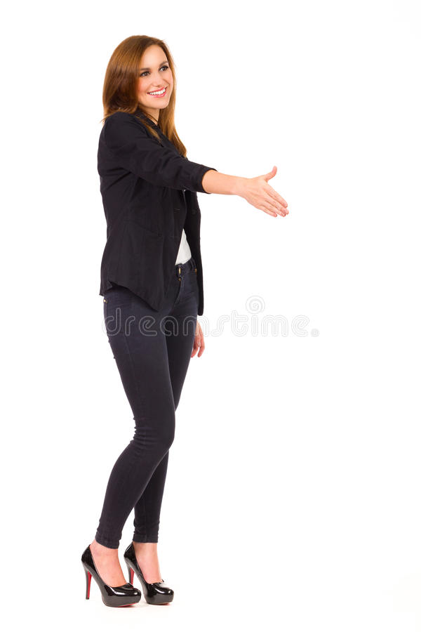 Η επιχειρησιακή γυναίκα με διανέμει για να τινάξει. στοκ εικόνες