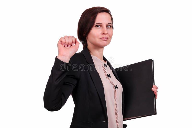 Η επιχειρησιακή γυναίκα με το φάκελλο στοκ εικόνα