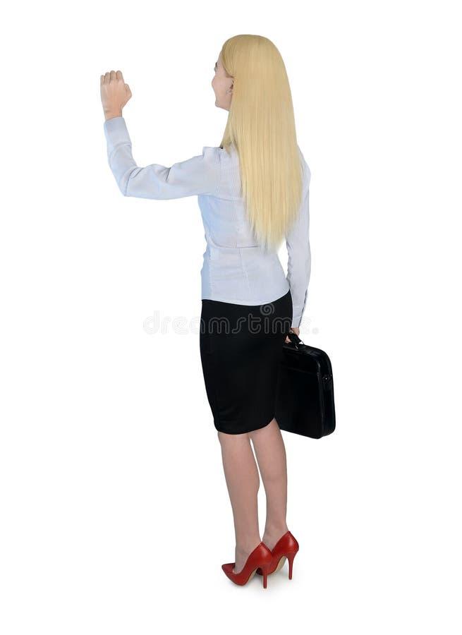 Η επιχειρησιακή γυναίκα χτυπά κάτι στοκ εικόνες