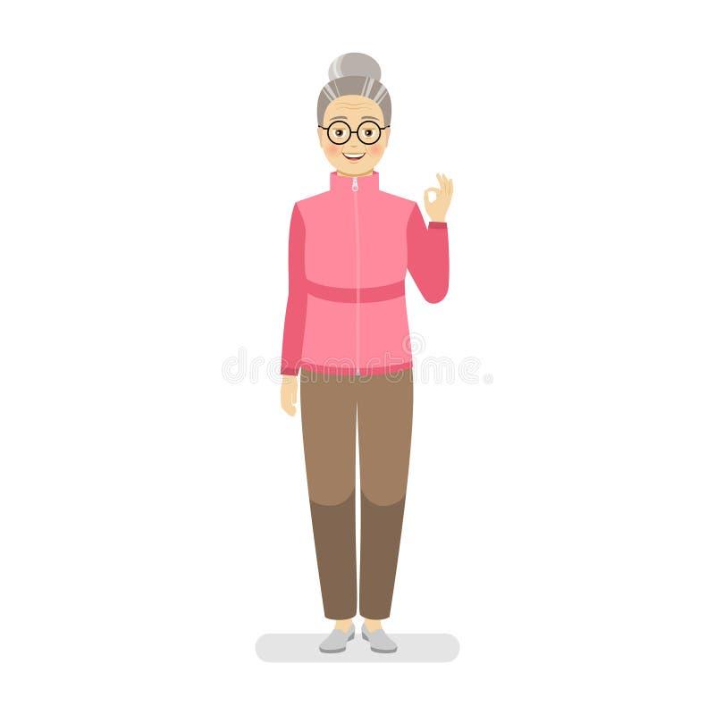 Η ευτυχής γιαγιά σε ένα αθλητικά ρόδινο πουλόβερ και καφετιά εσώρουχα παρουσιάζει μια χειρονομία τέλεια Πρόστιμο χειρονομίας χερι απεικόνιση αποθεμάτων