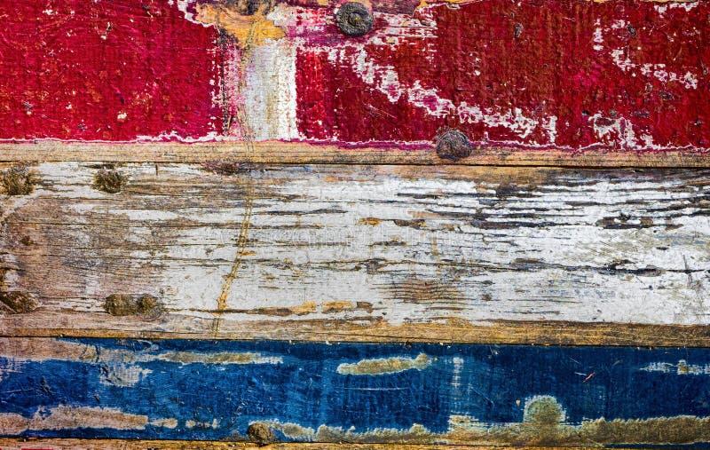 Η ζωηρόχρωμη εκλεκτής ποιότητας αγροτική floorboards σημαία των Κάτω Χωρών ή ολλανδικά σημαιοστολίζει τα χρώματα στοκ εικόνα με δικαίωμα ελεύθερης χρήσης