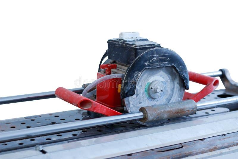 Η ηλεκτρική πορσελάνη κόβει το κεραμίδι κεραμιδιών Τέμνων εξοπλισμός απομονωμένος στοκ φωτογραφίες με δικαίωμα ελεύθερης χρήσης