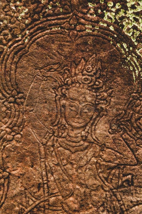 Η θηλυκή λεπτομέρεια ανακούφισης Bas προσώπου σε Angkor Wat, Siem συγκεντρώνει, Καμπότζη, Indochina, Ασία στοκ εικόνες