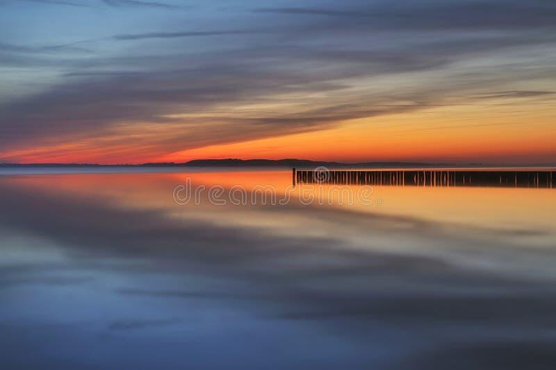 Ηλιοβασίλεμα πέρα από το νησί Rugen στοκ εικόνα με δικαίωμα ελεύθερης χρήσης