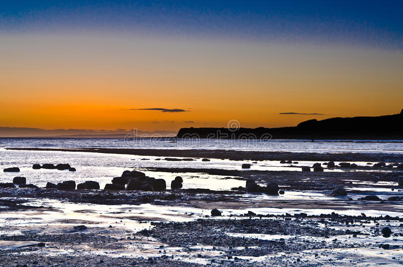 Ηλιοβασίλεμα Kimmeridge στοκ εικόνες