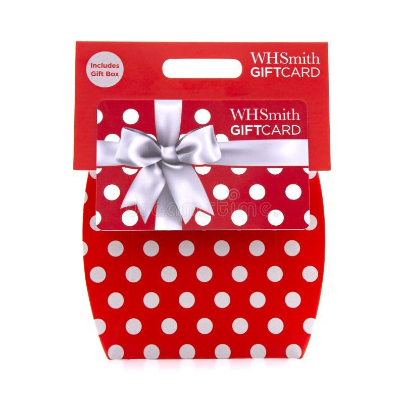 Η κάρτα δώρων Χ Smiths σε ένα άσπρο υπόβαθρο περιλαμβάνει το κιβώτιο δώρων στοκ φωτογραφία
