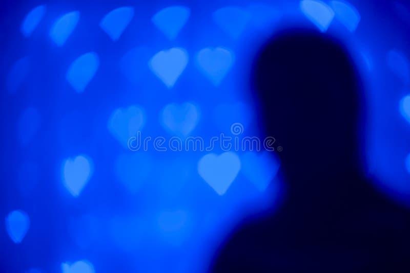Κάρτα ημέρας βαλεντίνων με τις καρδιές και τη σκιαγραφία στοκ φωτογραφίες