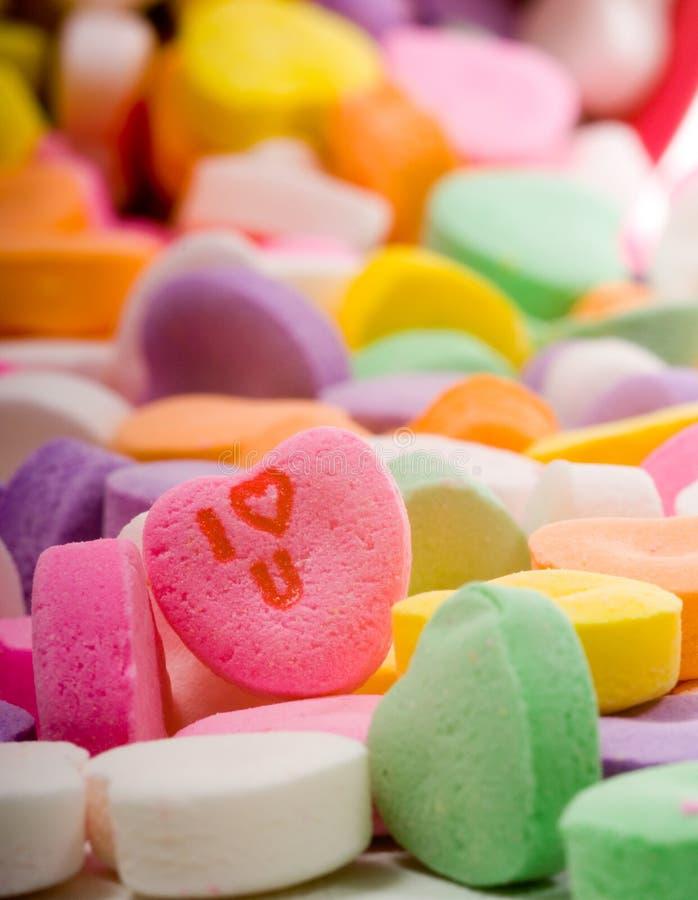 η καρδιά ι καραμελών σας αγαπά στοκ εικόνες