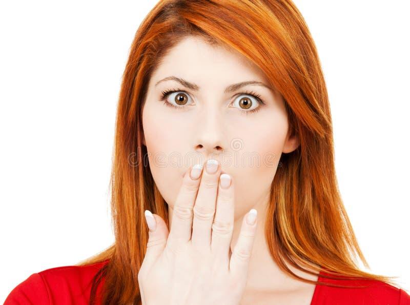 Η κατάπληκτη γυναίκα με παραδίδει το στόμα στοκ φωτογραφία