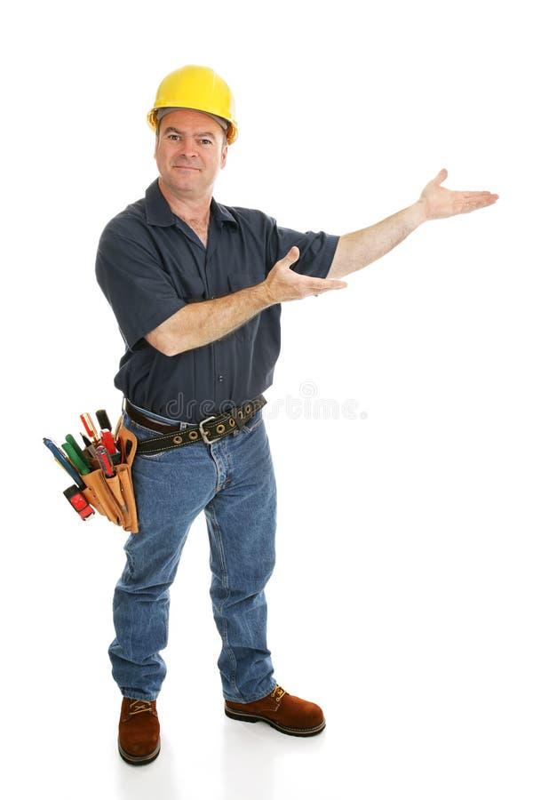 η κατασκευή παρουσιάζει τον εργαζόμενο στοκ εικόνα με δικαίωμα ελεύθερης χρήσης