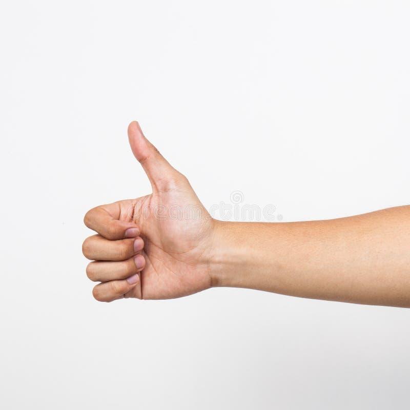 Η κινηματογράφηση σε πρώτο πλάνο του αρσενικού χεριού που παρουσιάζει αντίχειρες υπογράφει επάνω στοκ εικόνα