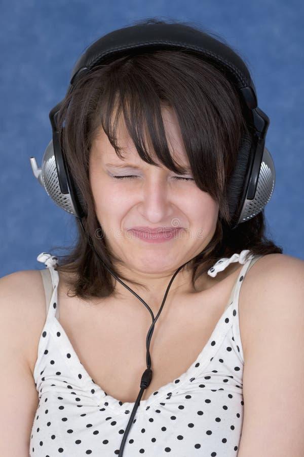 η κυρία προσώπου ακουστ& στοκ φωτογραφία με δικαίωμα ελεύθερης χρήσης