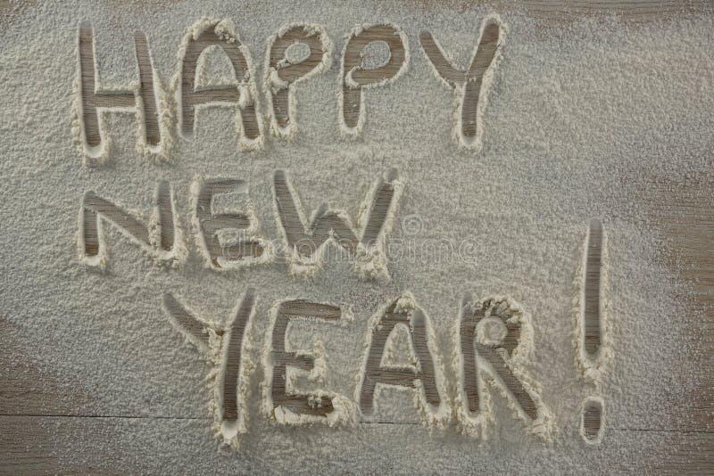 Η λέξη καλή χρονιά που γράφεται στο ψεκασμένο αλεύρι στοκ φωτογραφίες με δικαίωμα ελεύθερης χρήσης