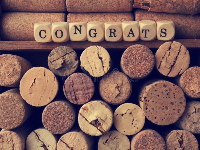 Η λέξη congrats με το φελλό μπουκαλιών στοκ φωτογραφίες με δικαίωμα ελεύθερης χρήσης