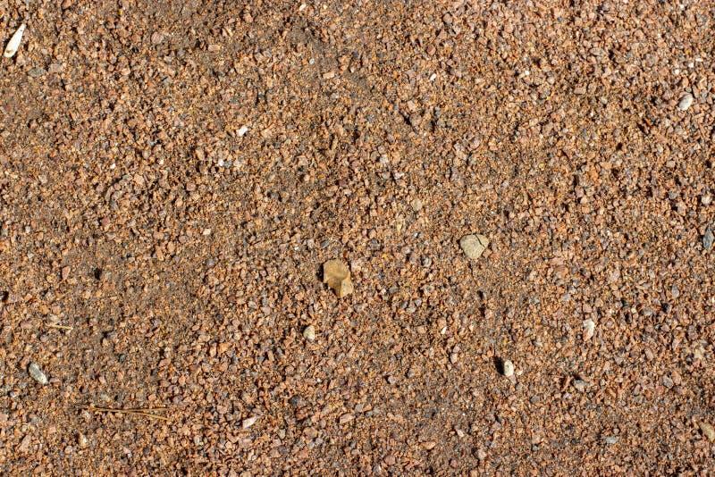 Η μαλακή κάλυψη του αμμοχάλικου διάβασης πεζών συνέτριψε το ψίχουλο πετρών, δομή σύστασης υποβάθρου στοκ φωτογραφία με δικαίωμα ελεύθερης χρήσης