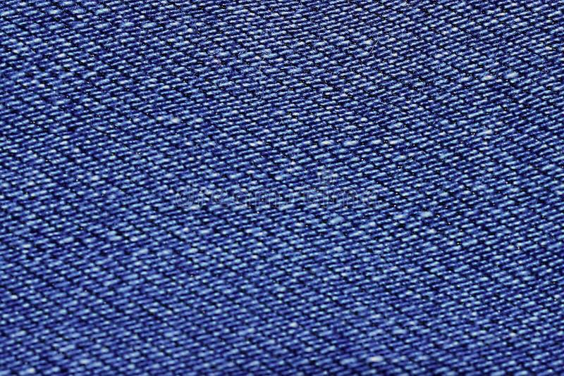 Η μπλε σύσταση από ένα κομμάτι των τζιν θόλωσε τονισμένος στοκ εικόνα με δικαίωμα ελεύθερης χρήσης