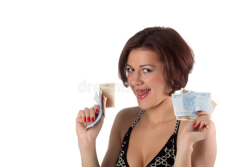 Η νέα γυναίκα κρατά τα χρήματα στοκ φωτογραφία