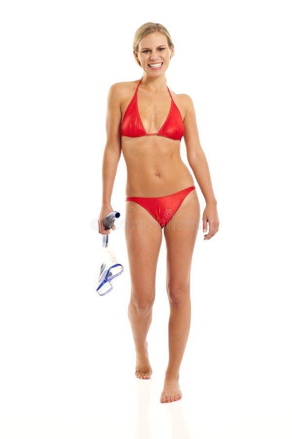 Η νέα γυναίκα με κολυμπά με αναπνευτήρα στοκ εικόνα με δικαίωμα ελεύθερης χρήσης