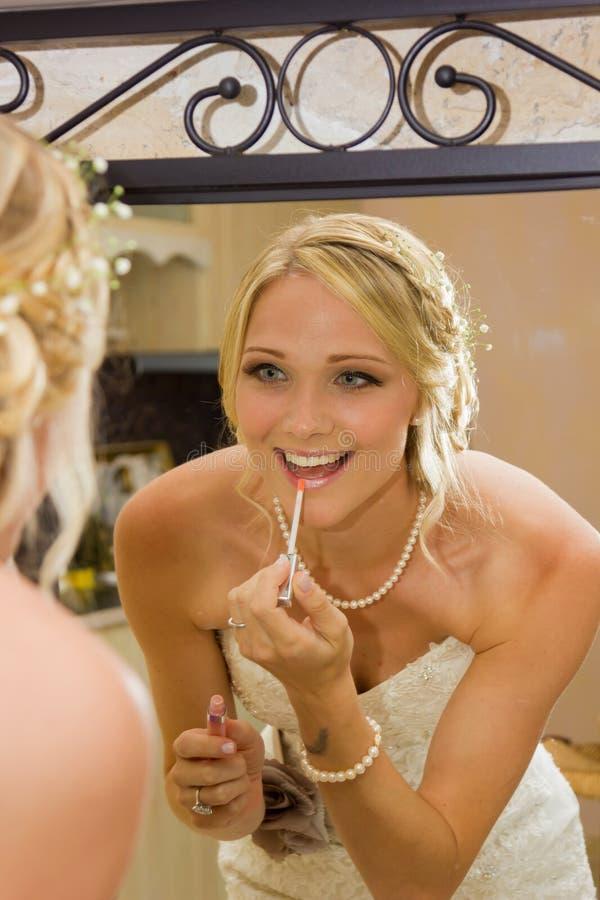 Η νύφη προσθέτει ότι κάποιο χείλι σχολιάζει στοκ εικόνα με δικαίωμα ελεύθερης χρήσης