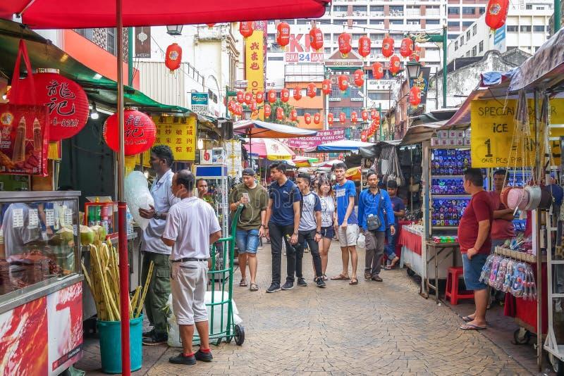 Η οδός Petaling είναι ένα chinatown που βρίσκεται στη Κουάλα Λουμπούρ, Μαλαισία Συσσώρευσε συνήθως με τους ντόπιους καθώς επίσης  στοκ εικόνα