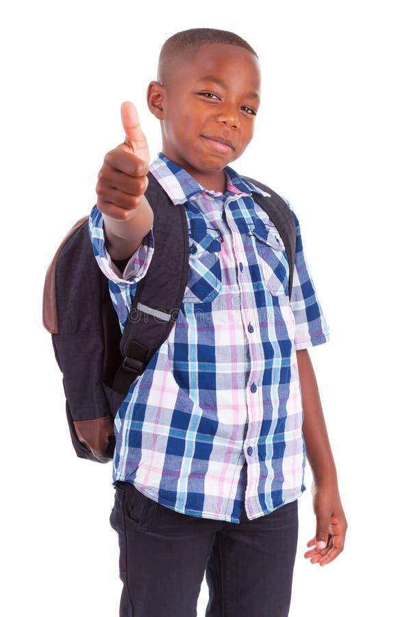 Η παραγωγή σχολικών αγοριών αφροαμερικάνων φυλλομετρεί επάνω - μαύροι στοκ φωτογραφία