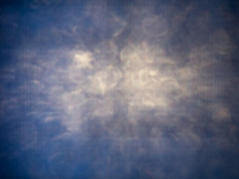 Η περίληψη σύστασης bokeh το μπλε λάμπει στοκ εικόνα