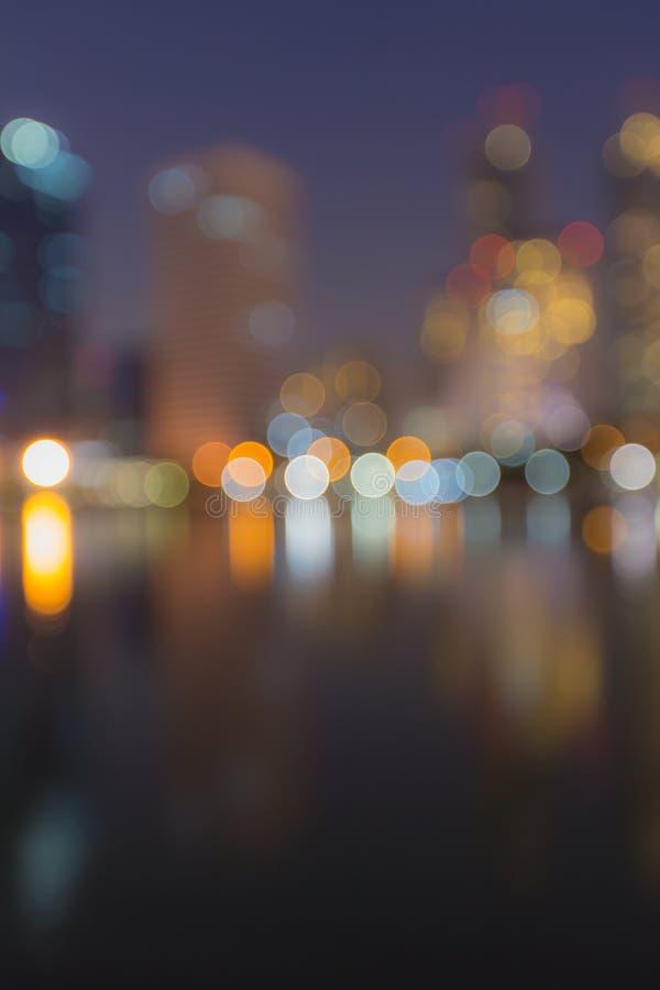 Η περίληψη, ελαφριά θαμπάδα εικονικής παράστασης πόλης νύχτας bokeh, το υπόβαθρο στοκ εικόνες