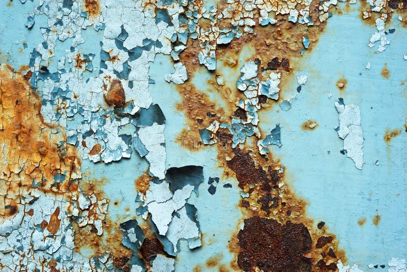 Η περίληψη διάβρωσε το ζωηρόχρωμο ταπετσαριών grunge υποβάθρου χρώμα αποφλοίωσης τοίχων σιδήρου σκουριασμένο καλλιτεχνικό στοκ εικόνες